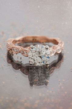 Rose gold engagement ring with cosmic beauty.
