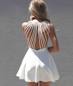 Amazing back detail dress with a center back zip closure.