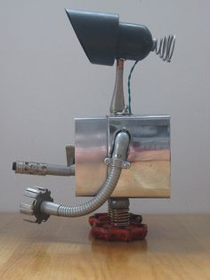 """Vintage dryer timer, door stop neck, faucet handle feet.  12"""" tall."""
