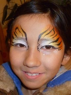 Tiger Striped Eyes by paintedparty, via Flickr