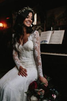 The lace sleeves on this beautiful gown are oh-so-sweet!