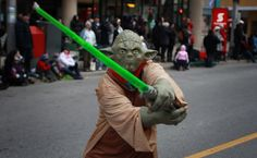 great way to keep people back from ambushing a parade....lightsabers...:):):)
