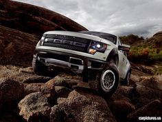 real world white Ford F-150 SVT Raptor out off roading