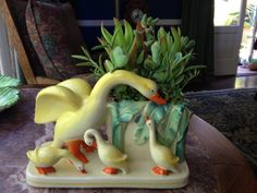 Vintage swan planter with succulents
