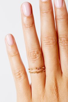 The Tiny Stone Ring by SARAH & SEBASTIAN is a band-style ring created in 14k gold featuring scattered stones in various colours. Nickel free.
