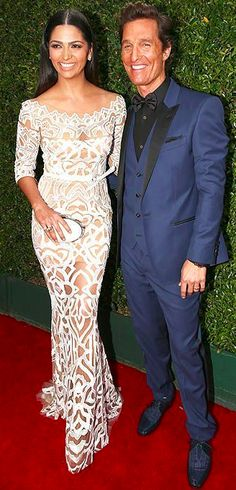 Camilla dazzled in a white gown from Zuhair Murad's Resort 2015 RTW Collection. Matthew looked suave as ever in a dark blue tux with black lapels from Dolce & Gabbana. #EMMYS 2014