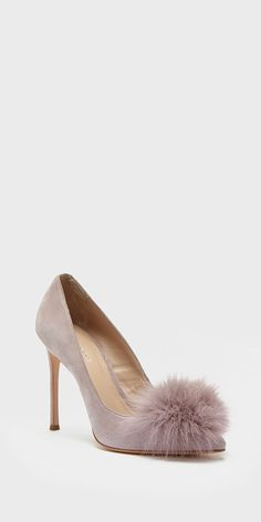 This sophisticated suede pump in stunning dusty lilac is runway-ready with its stiletto heel and furry pom pom pointy toe.