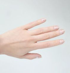 That's an idea! Nude polish and white lines