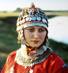 Girl from Chuvashia region  (Volga river area) wears the surpan, traditional wedding hat of chuvash' women. The main idea of the hat was to protect the mind and the soul from evil.