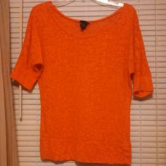 Fun bright orange top This comfy top is in like new condition with its shear to solid orange pattern Rue 21 Tops Blouses