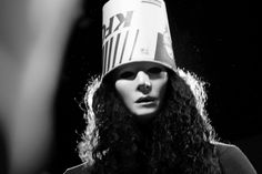 ...born in a coop raised in a cage children fear him critics rage he's half alive he's half dead folks just call him BUCKETHEAD