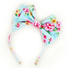 Lolita bow headbow bright blue and pink floral print. $15.00, via Etsy.