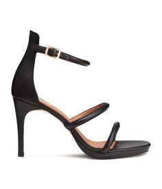 Check this out! PREMIUM QUALITY. Leather sandals with a covered heel. Ankle-high leg section and adjustable ankle strap with metal buckle. Imitation leather linings and insoles. Rubber soles. Heel height 4 in. - Visit hm.com to see more.