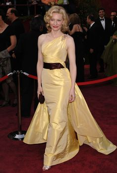 Style darling Cate Blanchett wore a lemon colored Valentino frock to the 2005 Academy Awards. The dress featured an asymmetrical train and a maroon stain bow belt.-pin it by carden