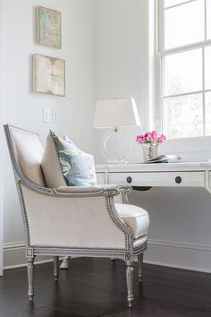 French office features a whitewashed French desk topped with a Ring Form Large Table Lamp, paired with a gray framed bergere chair upholstered in cream. | The French Mix Interior Design