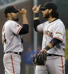 San Francisco Giants closer Sergio Romo, left, celebrates with shortstop Brandon Crawford after they defeated the Chicago Cubs 7-6 in a baseball game in Chicago, Thursday, April 11, 2013.