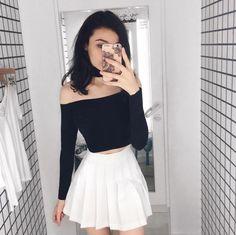 @sh1mxx wears the Tennis Skirt + Mid Length Chocker Top.