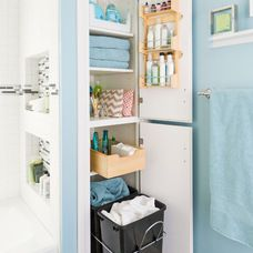 Traditional Bathroom by Lowe's Home Improvement. We have this same narrow deep closet space. Tips here to use it better/organize...