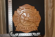 Firemans Maltese Cross - Carved out of Oak. We love all things that are wood and interesting. Here are some items you can purchase from Etsy or even through Paypal. Check us out. www.facebook.com/... or www.tawoodandviny... Check our shop out on Etsy at https://www.etsy.com/shop/TAWoodandVinyl?ref=si_shop