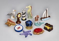 Limited Edition Hand Painted Nautical Wonderland Figurines storage tin included for$40  Wish I could afford it.