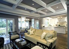 white kitchen, coffered ceiling in family room