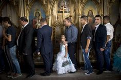 Sept. 8, 2014. People pass by icons during a religious service at the Bistrita Monastery in Costesti, Romania.