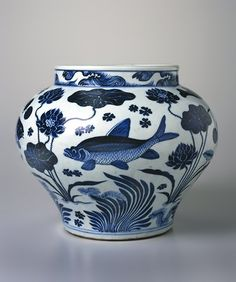 Wine Jar with Fish and Aquatic Plants Brooklyn Museum's  wine jar is widely considered a masterpiece of underglaze cobalt blue and white porcelain for the deep color of its decoration, its strong contours, and the  fit of the design of fish and water plants to its form. 14th century Yuan Dynasty, China