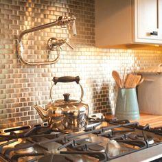 Love the stainless steel tile backsplash!