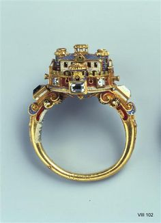 Ring with Castle perhaps Italian, 2nd half of 16th century Green Vault Inventory number VIII 102 Material and Technology Gold, Diamond, Email Mass H 2.8 cm, 2.3 cm B Property name Ring Comment The rings that time characterized by great diversity of forms and themes and are mostly decorated with fine ornaments and gemstones.
