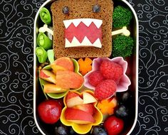 For your little monster: This lunch featured on Happy Little Bento is absolutely too cool not to share. The sandwich was made using rye bread with grapes for eyes, mozzarella cheese for the teeth and a plum for the mouth. Also included in this awesome bento box: peaches, nectarines, grapes, raspberries, snap peas, broccoli and carrots. Pretty darn cute if you ask us!