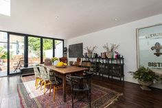 Gorgeous dining room with bus roll upholstered chairs