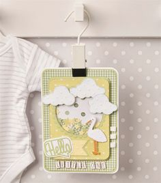 Say 'hello' to a new little bundle with this lovely, neutral, layered card. Its spring-like colours make it perfect for a boy or girl and means it can be made in advance if you're waiting to be surprised!