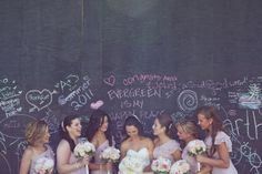 "chalkboard ""graffiti"" wall. nice idea. #wedding"