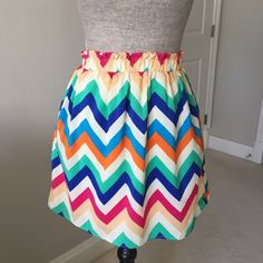 Rainbow color chevron skirt Super cute! Chevron print skirt in rainbow of colors with elastic waist and pockets! Fully lined. 100% polyester. Measurements: Waist:25 inches (not stretched) Length: 16.5 inches Annabella Skirts