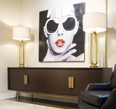 A fabulous Selva console from Italy and dramatic wall art in our Barrymore Furniture showroom. Cool and sleek and contemporary.