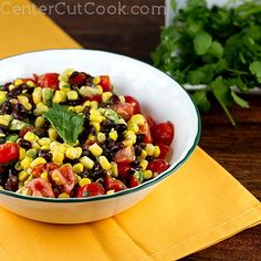 Fresh corn, tomatoes, black beans, cilantro, and avocado with a red wine vinegar and olive oil dressing!! REALLY GOOD!! Great outside party dish!!!
