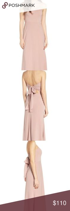 """JENNY YOO Collection Kylie Tie Back (Size 16) $275 Details     A dramatic tie in back punctuates this cleanly styled strapless gown with a flattering sweetheart neckline and figure-skimming A-line silhouette. Bare shoulders and a peekaboo lower-back keyhole finish the look with subtle allure.     - Approximate length: 55 1/2""""     - Hidden back-zip closure; ties behind back     - Strapless sweetheart neck     - Full-length A-line skirt     - Lined     - 100% polyester     - Dry clean…"""