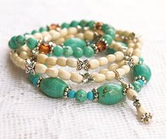 Turquoise Stretch Bead Bracelets with White and Silver Beads with Dangle Charm via Etsy