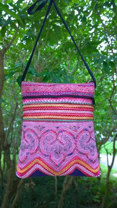 A personal favourite from my Etsy shop https://www.etsy.com/sg-en/listing/235916923/pink-boho-crossbody-bag-hmong-crossbody