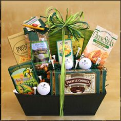 """ Fore the 19th Hole"" ~ From Jo-Ann's Gift Basket Potpourri ~ Hit a hole in one with this great gift for the ""Golf Fanatic"". Our handsome keepsake tray is filled with apres-golf goodies: cheese, crackers, cheese sticks, chocolate truffle cookies, smoked almonds, English tea cookies, ""par-tee"" snack mix, three golf balls and a bunch of tees. Just right for the 19th hole! www.joannsgbp.com"
