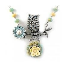 cute owl necklace on a branch with flowers, lots of flowers