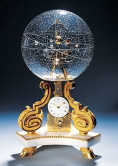 The planetarium clock pictured below is an absolute work of art. It was made in 1770 in Paris.