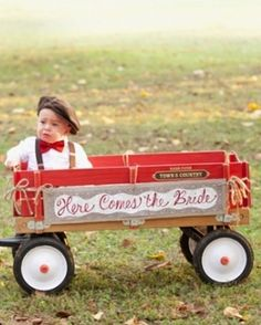 Cute ... here comes the bride sign wagon.