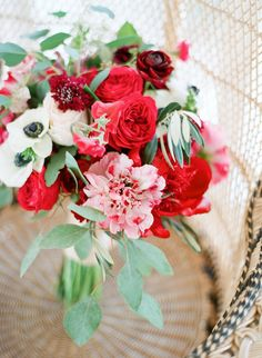 red bouquet with anemones - photo by Sophie Epton Photography http://ruffledblog.com/modern-romantic-wedding-with-boho-details