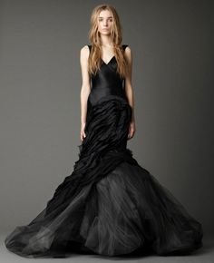 Black bias cut crepe-back satin V-neck mermaid gown with open back and tumbled tulle laser cut scallop skirt with washed organza flange