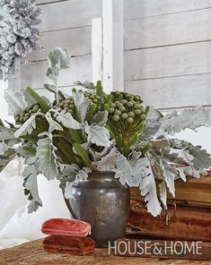 Winter blooms take pride of place in a vintage iron pitcher. | Photographer: Valerie Wilcox | Designer: Lorren Leveille