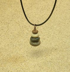 Simple, Earthy and natural describes this beautiful miniature cairn necklace…
