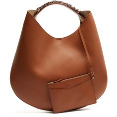 Tan-brown calf leather brings a sophisticated mood to Givenchy's Infinity hobo bag. The slouchy silhouette is the product of fine Italian craftsmanship, featu…