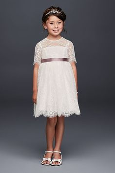 Fringy eyelash lace scallops give the hem and 3/4-sleeves of this fit-and-flare flower girl dress extra-sweet detail.   Polyester  Back zipper; fully lined  Dry clean  Imported Shown with STNRBN sash
