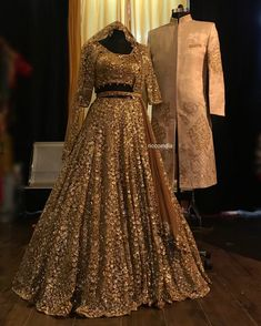 Copper gold Lehenga with resham and sequin work and cut work dupatta. 95000 Beige sherwani with intricate dori and zari work embroidery. Indian Bridal Outfits, Indian Bridal Lehenga, Pakistani Bridal Dresses, Indian Designer Outfits, Golden Bridal Lehenga, Designer Bridal Lehenga, Couple Wedding Dress, Wedding Reception Outfit, Wedding Dresses